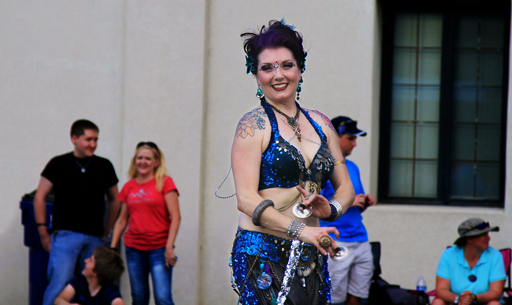 A Dancer shows her skills during the Wichita River Festival Parade.